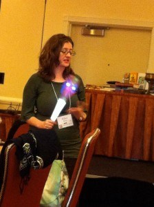 "Me holding the ""talking stick"" (aka Wand of Power) during Theresa's breakfast roundtable, photo by Helena Aislin"